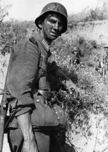 A weary German soldier poses for the camera during a break in the action.
