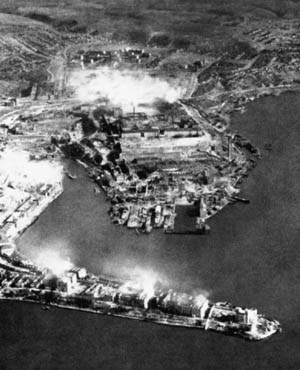 In an aerial shot of the city, plumes of smole and clouds of rock rise above Sevastopol during the German bombardment.