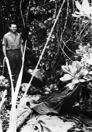 One of the Australian raiders hides the small, two-man canoe he and a comrade paddled to an island near Singapore harbor.