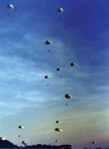 At Albrook Field in the Panama Canal Zone, the 551st Parachute Infantry Battalion performs a demonstration jump before a large crowd during a war bond drive in February 1943.