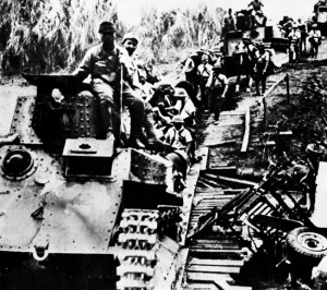 In a rare photo that includes Japanese armored vehicles, victorious infantrymen cross a makeshift bridge during the advance through Burma. The Japanese capture of Rangoon marked a low point for the allies in the China-Burma-India Theater.