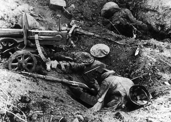 Two Red Army soldiers lie dead, one still holding his Mosin-Nagant rifle.