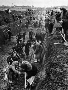 Moscow citizens cheerfully dig antitank ditches.