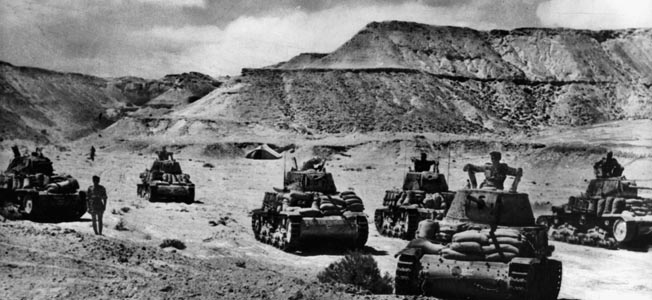 A British Bren carrier comes under enemy fire in the desert near the Alamein front several weeks before Montgomery's attack began on the night of October 23, 1942.