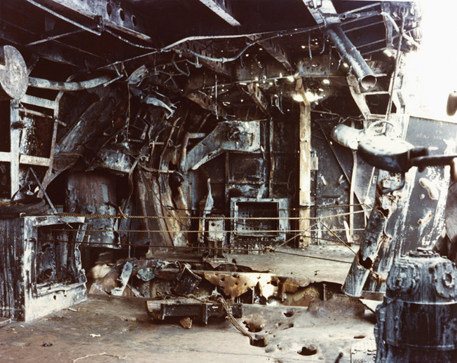 The gallery of one of the Enterprise's starboard 5-inch guns was heavily damaged by a Japanese bomb during the Battle of the Eastern Solomons. The Enterprise survived the battle and the war only to be sold for scrap.