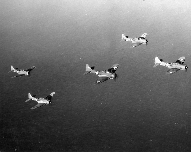 Following a bombing exercise during Task Force 16 maneuvers, a flight of Douglas SBD Dauntless dive-bombers returns to the Enterprise. Later replaced by the Curtis Helldiver, the Dauntless was the frontline carrier-based dive bomber of the U.S. Navy during the opening months of World War II.