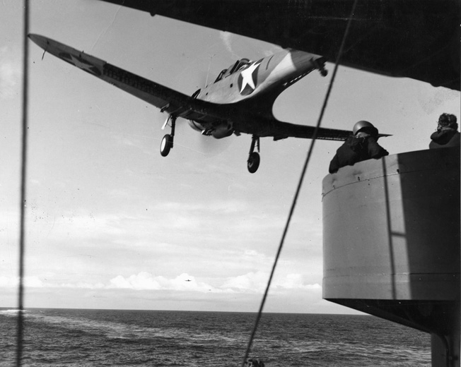 Carrying a 1,000-pound fragmentation bomb, a Douglas SBD Dauntless dive-bomber takes off from the deck of an American aircraft carrier to attack targets on the island of Guadalcanal on August 7, 1942.