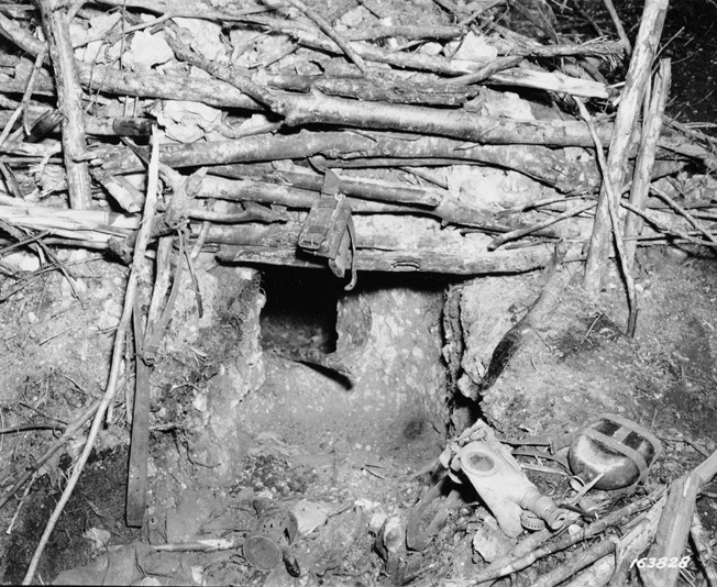 While clearing the small island of Tulagi of its Japanese defenders, U.S. Marines discovered dugouts and tunnels carved into the island's hillsides. These types of defenses were encountered many times during the American march across the Pacific toward the Japanese home islands.