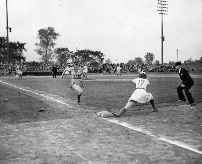 While many professional baseball players enlisted or were drafted into military service, Chicago Cubs owner William K. Wrigley formed the All-American Girls Baseball League.