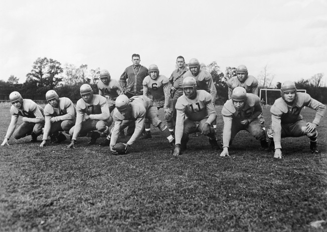 During a time when the U.S. military was segregated, American service personnel stationed in Great Britain formed a football team that included both black and white players. The U.S. military was desegregated in the late 1940s.