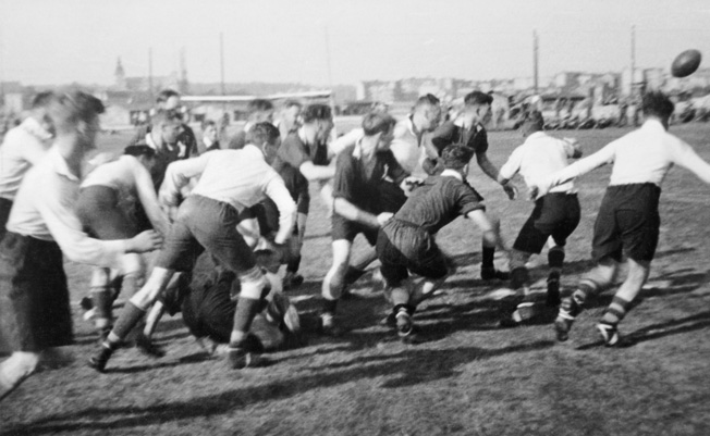 British prisoners of war engage in a game of rugby at Stalag XXID. Prisoners on both sides were often allowed to organize sports teams during the war, and the competition was spirited.