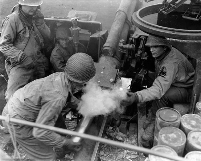 American artillery played a key role in blunting the initial drive by the Germans during the Battle of the Bulge. This photo was taken on December 21, 1944, during desperate fighting to support infantry positions contesting the German offensive.