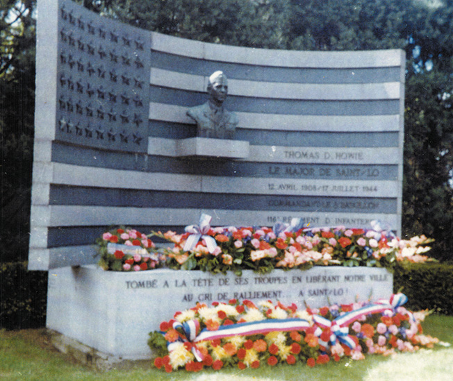In tribute to Major Howie, a memorial was erected by the French people in the town square of St. Lô.
