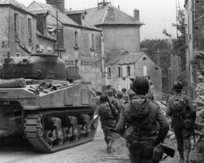 The 29th Infantry Division encountered heavy resistance as it moved down the main street of St. Lô.
