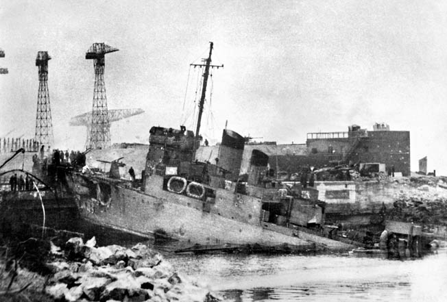 The Campbeltown lies atop the Normandie Dry Dock after the raid. The explosives detonated later than expected probably due to a malfunction in the detonators.