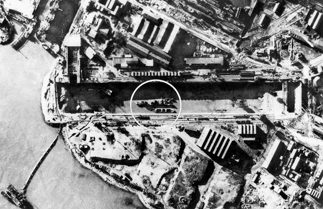 The Campbeltown lies inside the Normandie Dry Dock nine months after the raid. Although the dry dock used to repair surface ships was disabled for the duration of the war, the raid did not impede the Kriegsmarine's U-boat operations from the Atlantic port.