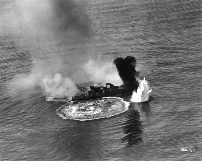During an aerial bombing exercise, the obsolete battleship USS Virginia takes a direct hit.