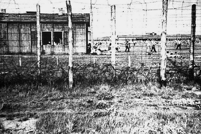 The spartan existence of life in a German POW camp is evident in this photograph depicting Barracks 6.