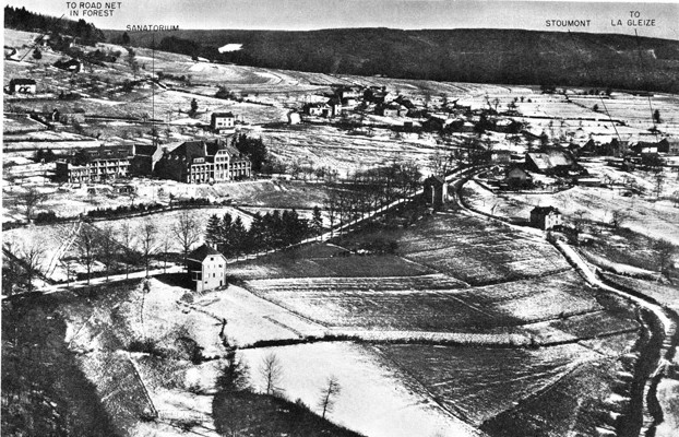 This aerial view depicts St. Edouard's Sanatorium at left center and the Belgian village of Stoumont at far right. Both locations were the scenes of heavy fighting during the desperate battle between the 740th Tank Battalion and elements of German SS Kampfgruppe Peiper.