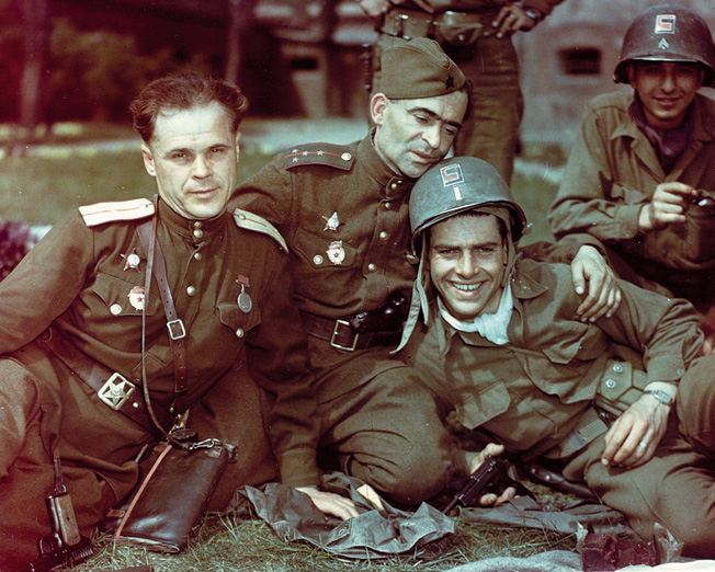 Russian soldiers and U.S. GIs of the 69th Division celebrate the linking of east and west at the German town of Torgau on the Elbe River.