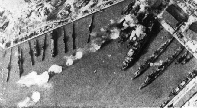 In this aerial view of the harbor of Tallin, Soviet ships are seen under fire from German field artillery and dive-bombers. When the Germans breached the Red Army defensive perimeter around the Estonian capital of Tallinn, the vessels along the waterfront became vulnerable to attack from the shore.
