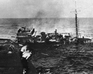 As the Chiyo Maru sinks beneath them, Japanese sailors are helped aboard the USS Tambor. U.S. submariners were often able to pick up survivors until reports of possible enemy activity forced them to withdraw.