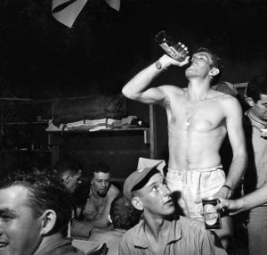Blowing off steam after the stress of a patrol into enemy waters, U.S. Navy personnel celebrate their return to port. Submarine duty was among the most hazardous in any branch of the service.