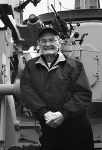 U.S. Navy veteran Robert Hunt poses aboard the submarine USS Cobia, which is on display as a floating exhibit at the Wisconsin Maritime Museum in Manitowoc. Hunt survived 12 combat patrols with the USS Tambor and recorded his impressions of war at sea in numerous letters.
