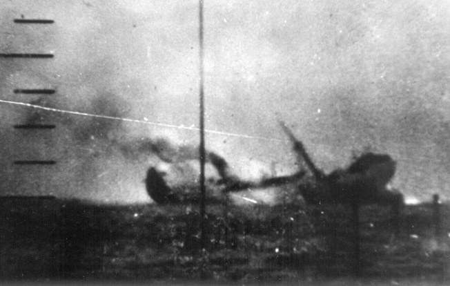 Its back broken by a torpedo from the USS Tambor, a Japanese freighter begins its plunge to the bottom of the Pacific. Note the rising bow and stern sections of the large vessel as smoke billows from its funnel.