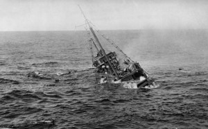 Panicked Japanese sailors cling to the rigging of the freighter Chiyo Maru as it settles beneath the waves. The USS Tambor had engaged the merchant ship with its deck gun in the South China Sea.