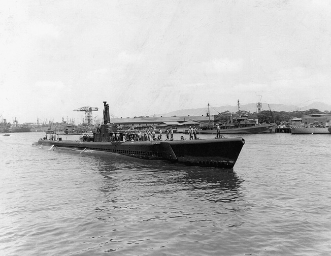 Making its way toward a berth at Pearl Harbor, the highly successful USS Tang comes into port.