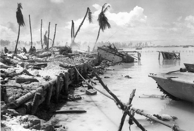 This well-known photo of the wrecked beach at Tarawa shows Don Crain's disabled amtrac in the distance (white circle). Although the amtracs sustained heavy losses, they were instrumental in the successful landings on the islet of Betio on November 20, 1943.