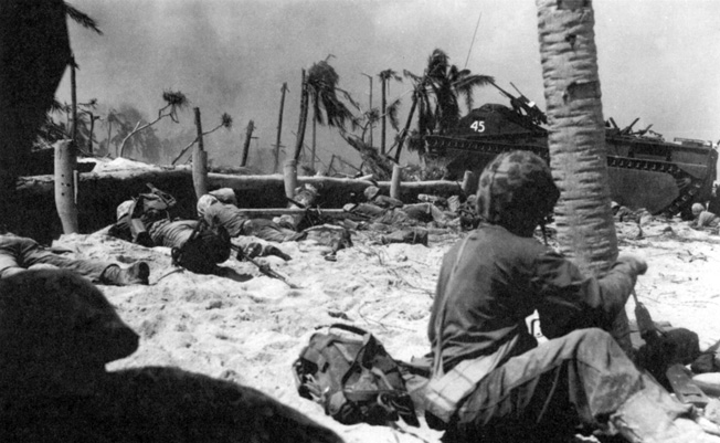 The Japanese defenders of Tarawa had constructed a labyrinth of pillboxes, blockhouses, and machine gun nests with interlocking fire. Here, moments after landing, members of E Company, 8th Marines find themselves under withering fire.