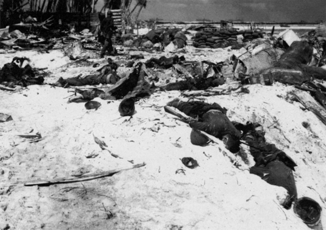 Japanese corpses sprawl i n the Pacific sun after their position was destroyed by attacking Marines. The Japanese paid a heavy price in the futile defense of Tarawa.