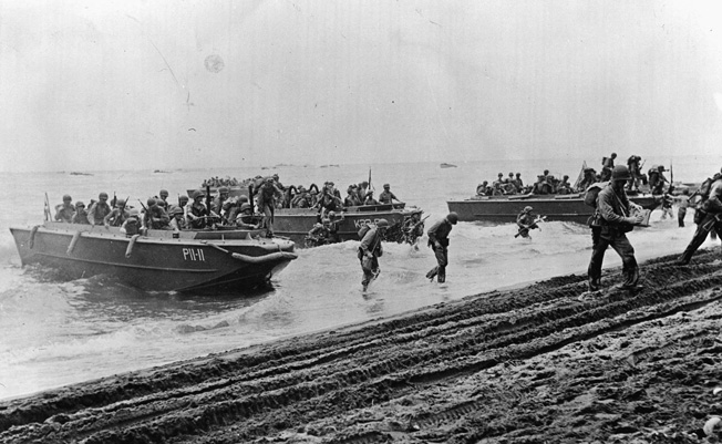 U.S. Marines land virtually unopposed on Guadalcanal in August 1942. The bloody campaign for the island in the solomons chain ended in February 1943, with the defeat of the Japanese. Guadalcanal marked the first U.S. land campaign of the Pacific War.