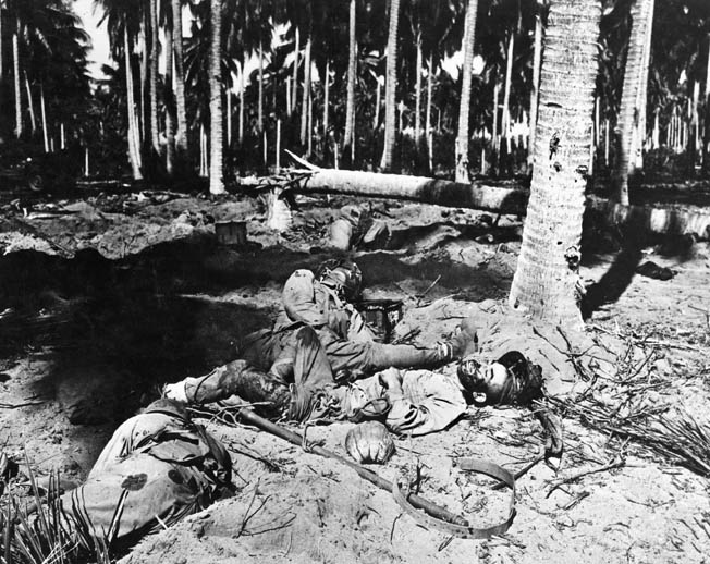 Dead Japanese soldiers lie half buried in the sand near the mouth of the Ilu River after a vicious fight with U.S. Marines on Guadalcanal that decimated the ranks of the Ichiki Detachment. The location was initially referred to as the Tenaru River due to a mislabeled map.