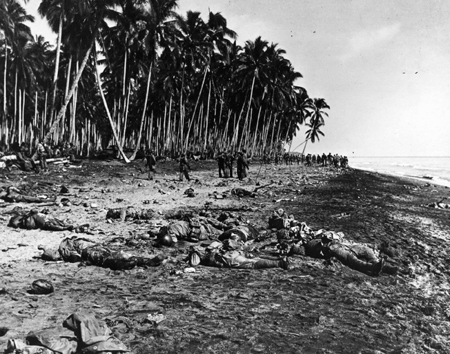 Slaughtered by U.S. Marine gunfire at the mouth of the Tenaru River the previous night, the jumbled corpses of Japanese soldiers litter the Guadalcanal beach in the morning sun. The Ichiki Detachment had provided the first concerted effort by the Japanese to drive the Americans off the island.