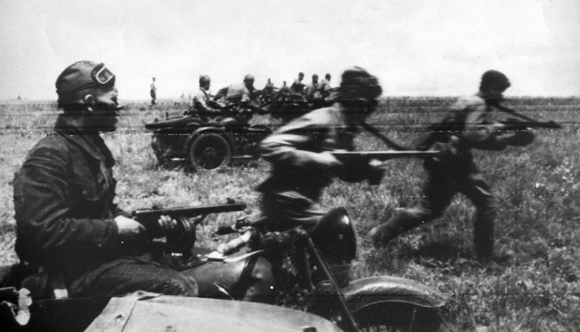 With infantry charging alongside, a motorcycle unit of the Red Army roars into action against German positions in July 1942. The submachine gun appears to be the weapons of choice for these soldiers.
