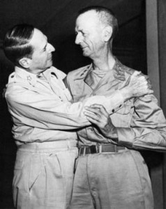 General Douglas MacArthur (left) embraces General Jonathan Wainwright after Wainwright's return from a POW camp in Manchuria.