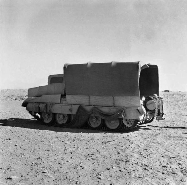 Photographed in June 1942, this Crusader tank has been fitted with the sunshield camouflage scheme to resemble a truck. Early testing of the sunshield system was highly successful.