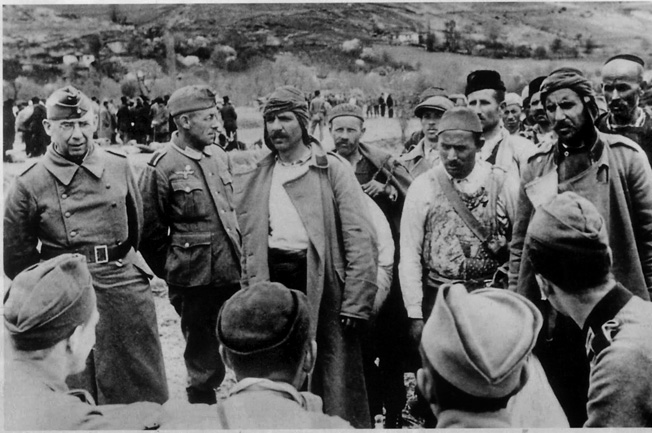 Often fickle with their loyalty, Albanian partisans meet with German officers in the rugged, mountainous country that proved as inhospitable to foreign influence as the partisans themselves.