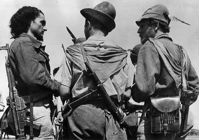 On June 16, 1945, Italian partisans gather at a soccer field in the Friuli District of Italy near Venice. The partisans had been instructed to turn in their arms and they complied- reluctantly in some cases.