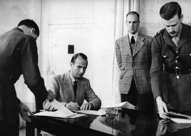 Representing General Karl Friedrich Otto Wolff, an SS major disobeys direct orders from Hitler and signs documents to surrender German forces in Italy. Other officers, both Allied and German, are clustered around the signer.