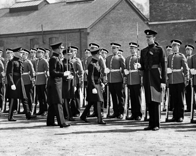 During his short reign, King Edward VIII inspects the troops of the 1st Battalion, Coldstream Guards, at Victoria Barracks in Windsor on April 24, 1936.
