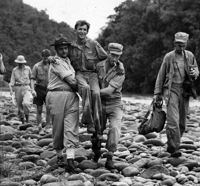 After being lost in the jungle of northern Burma for 45 days, a wounded and fatigued American pilot is carried to safety. Detachment 101 regularly assisted in the rescue of Allied airmen who had crashed or been shot down in the skies over Burma.