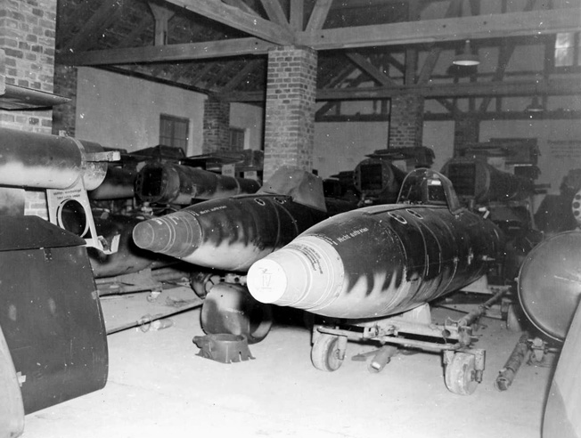 Bombs awaiting shipment to launching sites were found in sheds at the V-bomb assembly plant.