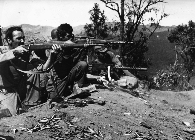 Approximately 80 miles north of Lashio, Burma, American infantrymen engage Japanese troops in a fight for control of a section of the Old Burma Road. The overland link was a vital supply connection for Allied troops fighting in the China-Burma-India Theater.
