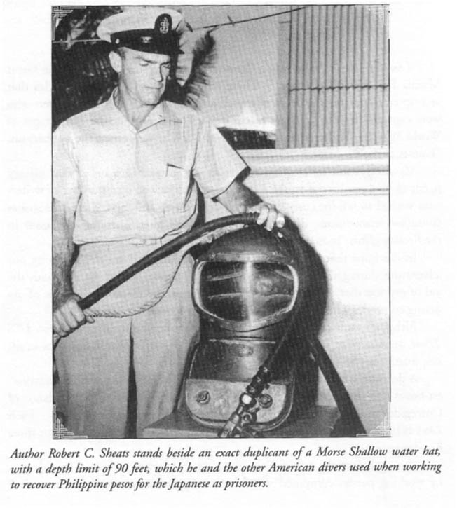 One of the U.S. Navy divers who worked to salvage the Filipino silver in Manila Bay, Robert Sheats published his experience in a book titled One Man's War: Diving as a Guest of the Emperor. In this photo, Sheats poses with a copy of the shallow water helmet used by the American divers.