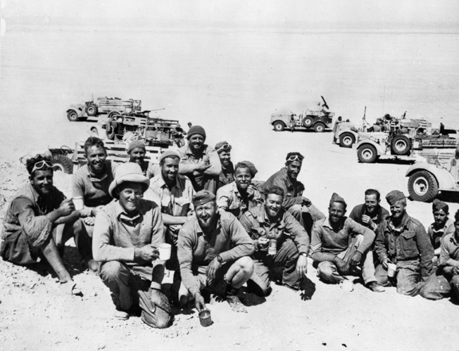 Following a successful foray behind enemy lines in the North African desert, members of the Long Range Desert Group pose for a photograph in March 1941.