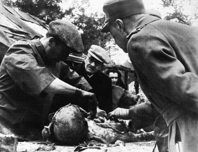 A pathologist dissects a body unearthed in the Katyn Forest during a German investigation of the incident.